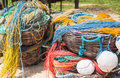 Color fishing net, floats, nylon rope in the basket on the bank Royalty Free Stock Photo