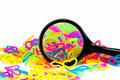 Color full elastic love heart shape loom bands close up with mag magnifying glass Stock Photos