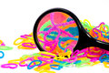 Color full elastic love heart shape loom bands close up with mag magnifying glass Stock Photography