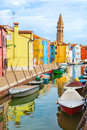 Color houses with boats on Burano island near Venice