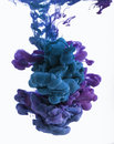 Color ink drop in water. Cyan, blue violet. Royalty Free Stock Photo
