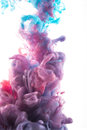 Color ink drop in water. redish violet, deep blue, glitter, cyan Royalty Free Stock Photo