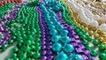 Color of mardigras purple green blue gold and white beads Royalty Free Stock Photos