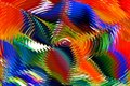 Color in motion mix of red orange blue green purple yellow black and white colors a pinwheel like pattern of radiating waves and Stock Photos