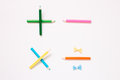 Color pencil maths symbols plus, minus, multiply and divide  on white background Royalty Free Stock Photo