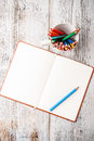 Color pencil notepad rustic wooden table Stock Image