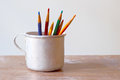 Color pencils in an aluminum mug subjects of graphics and fine arts Stock Photography