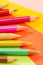 Color pencils on colorful papers close-up Stock Photos