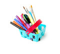 Color pencils, felt-tip pens, brushesin a blue toy basket isolated on  white background. School shopping theme. Royalty Free Stock Photo