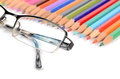 Color pencils and glasses Royalty Free Stock Photos