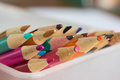 The color pencils lying in a basket close up Royalty Free Stock Image
