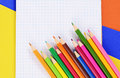 Color pencils on  paper with notebook Royalty Free Stock Photo