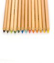 Color pencils in a row on white background Stock Images