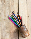Color pencils in rusty tin can Royalty Free Stock Photo