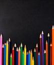 Color pencils set on a blackboard background Stock Images
