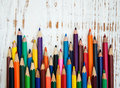 Color pencils set on a old wooden background Royalty Free Stock Photos