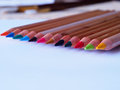 Color pencils on sketch pad close up Royalty Free Stock Photography