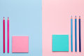 Color Pencils with Sticky Notes on Pastel Background Royalty Free Stock Photo