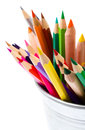Color pencils in tin can or pencil holders and green apple bac colored back to school supplies closeup top view Royalty Free Stock Photography