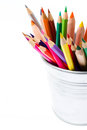 Color pencils in tin can or pencil holders and green apple bac rainbow back to school supplies closeup Royalty Free Stock Image