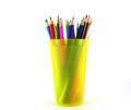 Color pencils in the yellow prop over white Royalty Free Stock Images