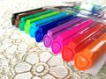 Color pens on lacework a pack of pen yellow orange red pink purple blue green blown and black Royalty Free Stock Image