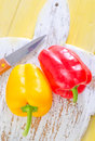 Color peppers on wooden board Stock Image