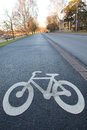 Color photo of an asphalt bicycle path in the city Stock Image