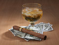 Color photo of a glass of whiskey and a big cigar Stock Photo