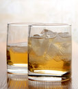 Color photograph of glasses of whiskey with ice Stock Photography