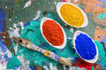 Color pigments in porcelain bowls on a wooden palette vibrant Royalty Free Stock Image