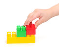 Color plastic blocks with hand Royalty Free Stock Photo