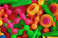 Color plastic cogs and shafts for kid playing Stock Photo
