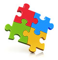 Color puzzle pieces creative business office teamwork partnership and communication corporate concept logo from four red blue Stock Image
