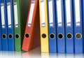 Color ring binders in row Royalty Free Stock Photo