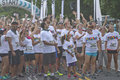 Color run racers eager to begin asheville north carolina usa july excited participants wait impatiently at the starting line for Royalty Free Stock Photography