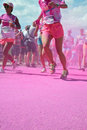 The color run in utrecht runners are showered with colored powder at pink station during netherlands Royalty Free Stock Photos