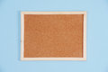 Color shot of a brown cork board in a frame Royalty Free Stock Photo