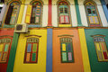 Color shutters and color facade of building in Little India, Sin Royalty Free Stock Image