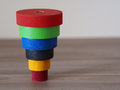 Color tower toy to ride built of wood Royalty Free Stock Photos
