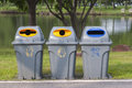 Color trash containers for seperate gabage in park. Royalty Free Stock Photo