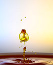 Color waterdrops collide each other Royalty Free Stock Photo