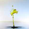 Color waterdrops collide each other Royalty Free Stock Images