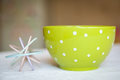 Color whisk and a green bowl with dots Royalty Free Stock Photo