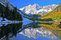 A colorado autumn at the maroon bells snow capped peaks of reflects in marron lake near aspen Stock Photo
