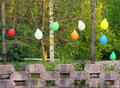 Colored balloons on the fence coloured sway in edge a birthday party Stock Photos