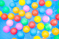 Colored balls floating in kiddie pool as background Stock Photos