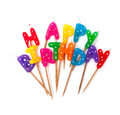 Colored birthday candles isolated on white form happy phrase Royalty Free Stock Photos