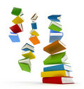 Colored books with clear cover falling in pile Stock Photo