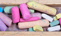 Colored chalks in wooden box Stock Photo